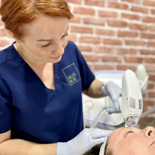 patient receiving Tixel skin treatment at SkinBox Clinic Fremantle